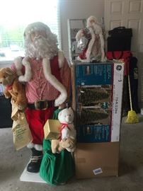 Life-size Santa and 7.5 foot pre-lit (white or colored) Christmas Tree!
