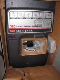 new in box, band saw and sander