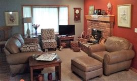 leather couch and arm chair, clocks, side tables, baskets