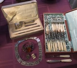 German 800 silver writing set in presentation box, amber & silver bracelet, Mexican sterling bracelet & earring set, antique European fish/shellfish set with mother of pearl handles in presentation box.