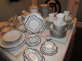 Royal Worcester Rosemary in dark blue. Ten place setting with serving pieces and cream soup. Noritake Reina and Duetto on either side.