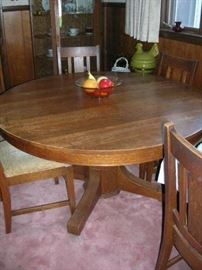 Pedestal oak dining table