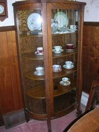 Bow front oak cabinet