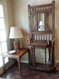 Antique hall tree with a glove box, small lamp table, hand carved canes.