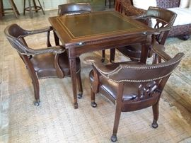 Game table and 4 leather chairs.