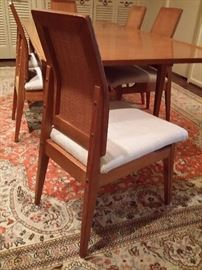 The bentwood back on the chairs is very unusual.  The entire set is like new.