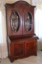 038c  Walnut Victorian secretary bookcase with oval glass doors and slant front, 93 in. T, 49 in. W, 24 in. D.