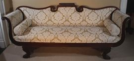 057a  Mahogany Federal sofa with winged carved legs and new Victorian style upholstery, 36 in T, 85 in. W, 24 in. D.