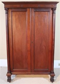 060a  Mahogany Empire gentlemens chest with fitted drawers, column front and claw feet, 64 in. T, 42 in. W, 27 in. D.