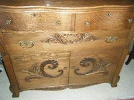 LOWER PART OF THE SIDEBOARD