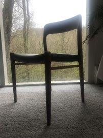 Niels Moller dining chairs by J.L. Moller, Denmark, sculptural teak frames with curved backrests, original black vinyl upholstery. Set of 6