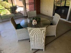 Very nice wicker patio set w/ glass round table..