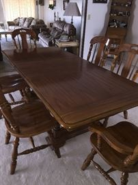 Dining room table with 2 captain chairs and 4 side chairs  with leaf   approx 30 inch ht  42 inch wide and 6 ft long, this includes the leaf   (leaf by itself 18 inch)