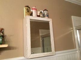 Some of powder tins & vintage bottles - wooden medicine cabinet with mirror in door