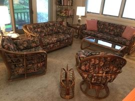 Sun room filled with vintage rattan furniture
