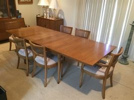"Drexel 98"" long x 40"" wide dining table.  Measurement includes the three 15"" leaves.  Two arm chairs, 4 armless chairs w/needlepoint seats and cane backs."