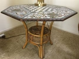 Rattan base table with handmade mosaic top.  You will see many of these handmade mosaic tables in all sizes throughout the house.  All are custom made, absolutely out of this world in design and detail.