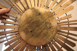artist signature on folk art sun