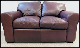 Leather upholstered twin sized hide-a-bed. Perfect for a child or smaller adult. Like new.
