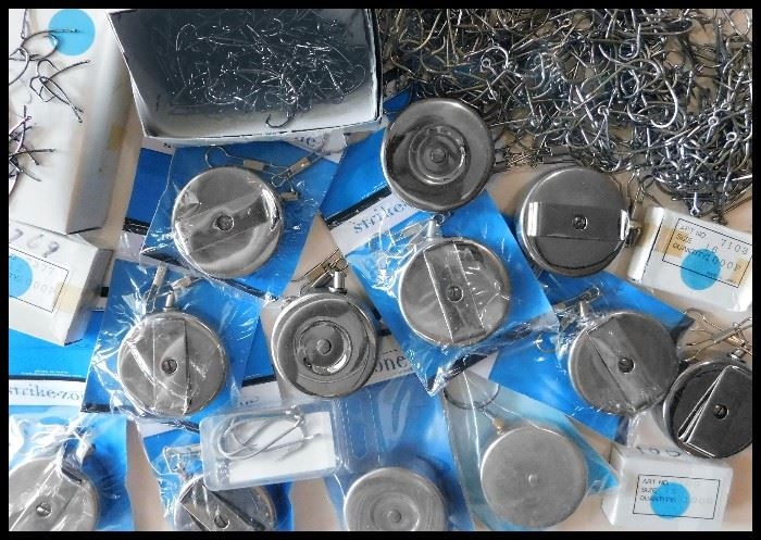 Many Retractors some with double clips plus boxes of fishing hooks.