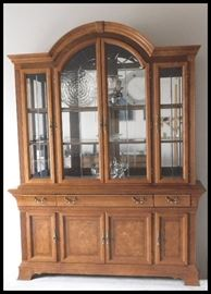 "Gorgeous wooden lighted hutch (buffet) with glass shelving and mirrors. Two pieces  19"" X 67"" X 86"" tall."
