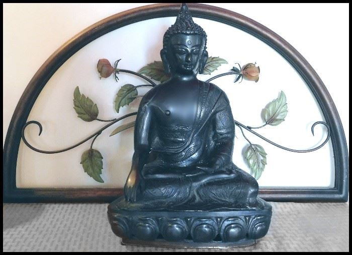 Two items: a Cast Bronze Asian Figurine of Bodhisattva plus a decorative metal floral panel in the background. Notice the lotus blossoms at the base, too.