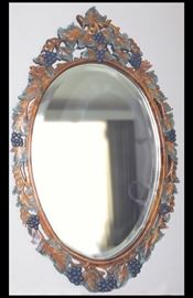 "Oval mirror with grape leaves. Purchased at Antique Restorations.   24"" x  40""."