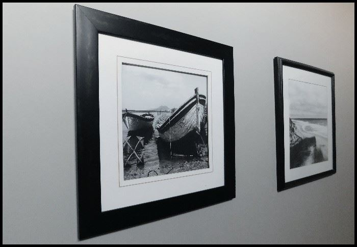 Sampling of framed black and white photographs. Various subjects including boats.