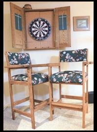 Pool Balls designed upholstered high chairs and dart board.