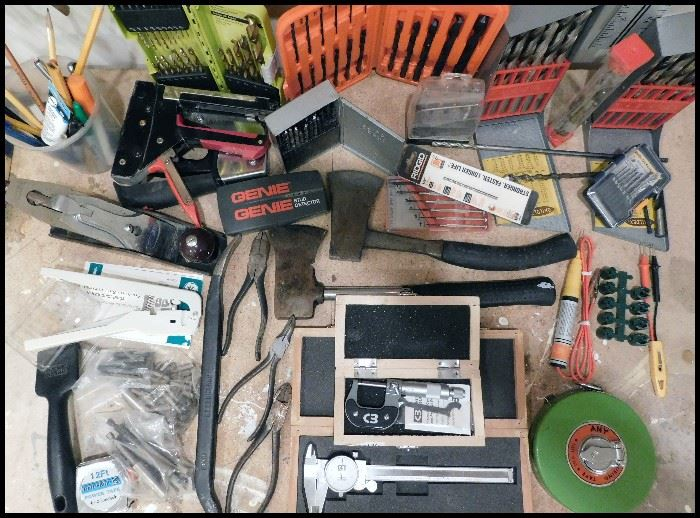 More tools including hatchets, drill bits, calipers, a wood plane and more.