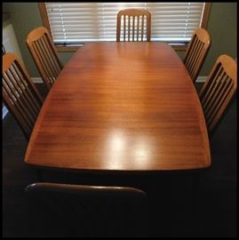 Danish modern table with six chairs.