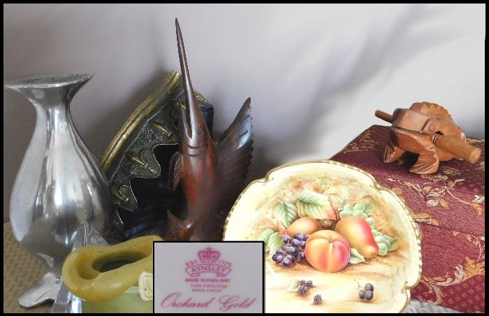 Collectibles including an Aynsley bowl, ironwood carving, sculptures and frog musical instrument.