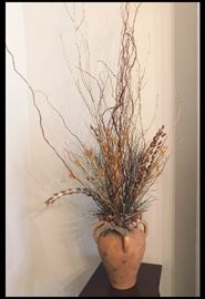 Decorative pot with dried flowers.
