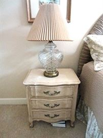 One of a pair of country French style night stands and cut glass lamps