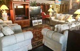 4-Piece Off-White sectional...sofa, love seat, and 2 matching chairs. All have fringed bottoms.