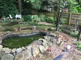 Fish Pond, Landscaping Stones, and Custom Made Mess Cover (front view)