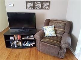 Big comfy brown armchair! Sony flatscreen tv. TV stand