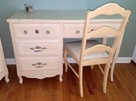 White juvenile desk with matching nightstand, dresser, and tall chest