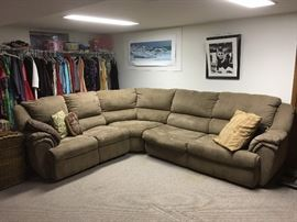 One of two sectional sofas for sale. This one is mocha microfibre sleeper sofa with a double pull-out bed.