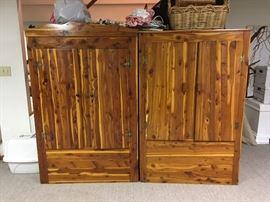 Two vintage cedar storage closets / armoires / wardrobes.