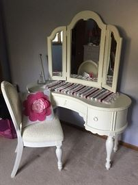 Girl's white vanity with triple, adjustable mirror and chair.