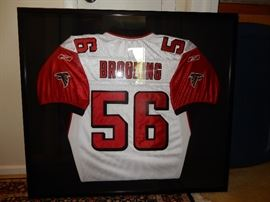 OFFERS ACCEPTED. Framed and Signed Keith Brooking Jersey,  size is 3  x 32 this was for an auction honoring wounded warriors. Keith Howard Brooking (born October 30, 1975) is a former American football linebacker in the National Football League (NFL). He was drafted by the Atlanta Falcons in the first round of the 1998 NFL Draft and also played for the Dallas Cowboys and Denver Broncos. He played college football at Georgia Tech. Brooking was a five-time Pro Bowl selection with the Falcons.