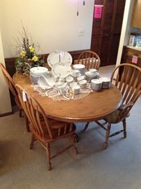 Oak Pedestal Dining Table with Two Leaves and Four Chairs, Set of Sango China Service for 12; Lovely Silk Flowers