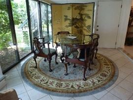 Asian urn dining table, carved wood base, glass top  4 Southwood corner chairs