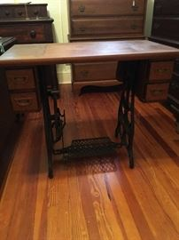 Antique sewing machine table made into a unique table