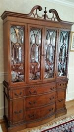 China cabinet with vintage curved glass