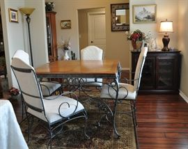 Square oak and metal dining table with 4 upholstered arm chairs, area rug, very attractive floor lamp and original art