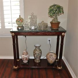 Attractive green marble top small scale console table with crystal and contemporary Asian pieces