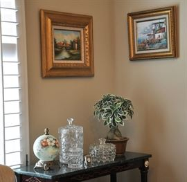 Corner view of the dining room with original art, the painted globe is actually an accent light.