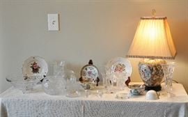 Display table in the dining room keeps changing and pieces move around.  Lovely table lamp, crystal, pair of Schumann (Germany) reticulated plates